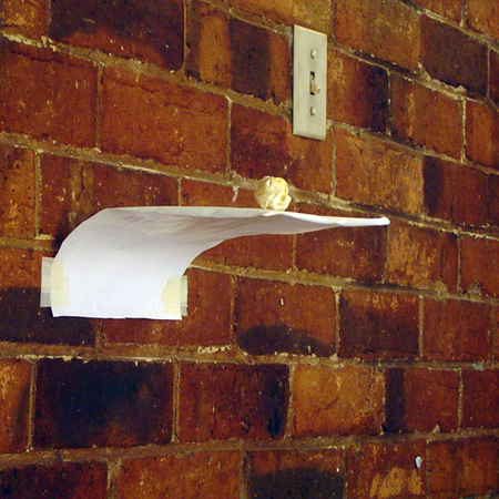 'Shelf with masking tape'